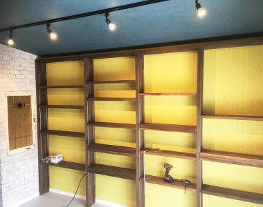 Atelier Blue Garage door BOOKSHELF WALLPAPER